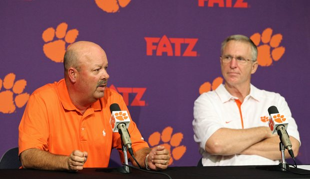 Clemson University athletic director Terry Don Phillips, right, listens as Clemson head men's golf coach Larry Penley answers a question during a press conference in Clemson, S.C. on Monday, July 18, 2011. It was announced on Monday that the school will add women's golf to its athletic program beginning with the 2013-14 academic year.