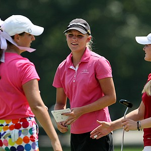 Alana Uriell, center, of California at the 63rd U. S. Girls' Junior Championship at Olympia Fields Country Club.