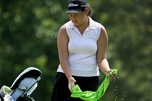 Stephanie Liu grabs a wet towel at the turn at the 63rd U. S. Girls' Junior Championship at Olympia Fields Country Club.