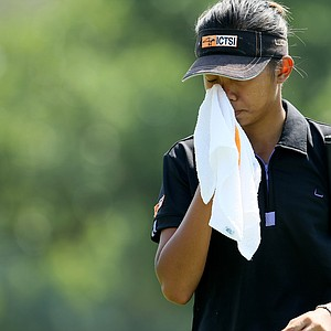 Lou Daniela Uy of the Philippines tries to keep cool at the 63rd U. S. Girls' Junior Championship at Olympia Fields Country Club.