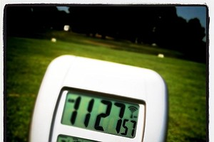 A time and temperature gauge sitting in the direct sunlight at the first tee shows the temperature reaching 115 degrees.
