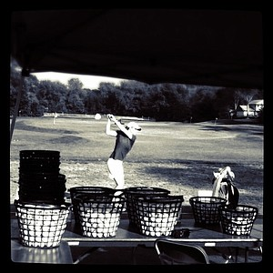 A player at the Girls' Junior Championship hits balls at the range after Tuesday's stroke play.