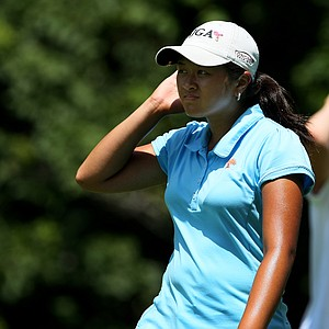 Lilia Khatu Vu walks off the 11th tee while competing against Casey Danielson during the Round of 64 at the 63rd U. S. Girls' Junior Championship at Olympia Fields Country Club.