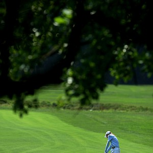 Caroline Araskog hits a shot at No. 9 during the Round of 64 at the 63rd U. S. Girls' Junior Championship at Olympia Fields Country Club.