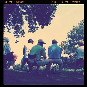 Spectators sit and watch the action during the Round of 64 at Olympia Fields.