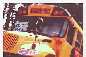 A school bus sits on course in case an evacuation is needed for inclement weather.