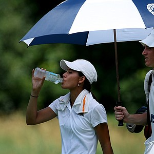 Aurora Kan finishes off a bottle of water after pouring most of it over her head during the Round of 32 at the 63rd U. S. Girls' Junior Championship at Olympia Fields Country Club.