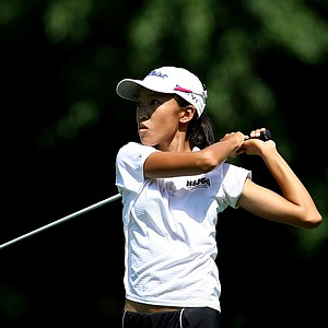 Eimi Koga hits her tee shot at No. 11 during the Round of 32 at the 63rd U. S. Girls' Junior Championship at Olympia Fields Country Club.