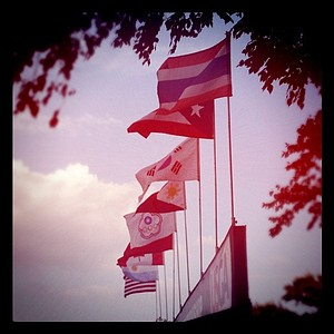 Flags fly over the scoreboard showing how many countries represented at the U. S. Girls' Junior.