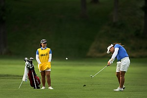 Ariya Jutanugarn hits a shot while her caddie/sister Moriya watches during Quarterfinals.