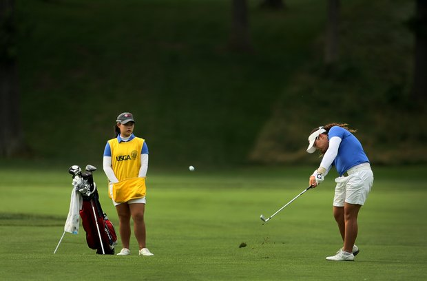 Ariya Jutanugarn hits a shot while her caddie/sister Moriya watches during Quarterfinals.