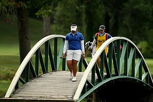 Ariya Jutanugarn and her sister/caddie Moriya walk across a bridge at No. 6 during Quarterfinals.