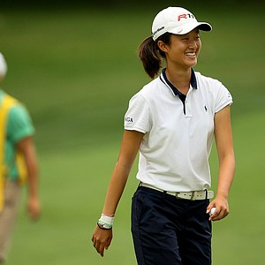 Yu Liu is all smiles at No. 9, she left the green 4-up, during Quarterfinals.