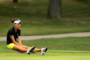 Karen Chung sits down at No. 9 after the horns sounded for a weather delay waiting for a ruling before sequin shelter, play was suspended ay 10 a.m.