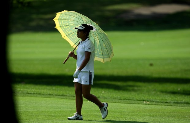 Amy Lee carries an umbrella to shield herself from the sun during Semifinals. She lost to Ariya Jutanugarn, 8 & 6.