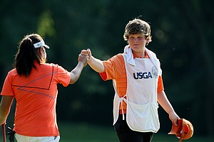 Dottie Ardina high fives her caddie, Mickey Brick, after they defeated Yu Liu during Semifinals.