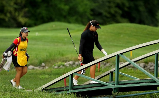 Ariya Jutanugarn, right, and her sister/caddie Moriya Jutanugarn walk cross the bridge at No. 15 during the morning round.