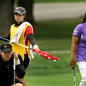 The duo of Ariya Jutanugarn, left, and her sister, Moriya on the bag, ended up being too much for Dottie Ardina, right, during the afternoon round of the final match. Jutanugarn defeated Dottie Ardina, 2 & 1.