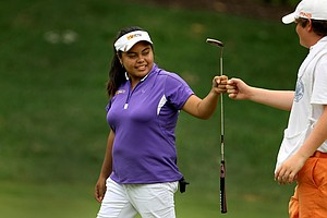 Dottie Ardina fist bumps with her caddie Mickey Brick during the afternoon round of the final match.