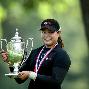 Ariya Jutanugarn poses with the Glenna Collett Vare Trophy after defeating Dottie Ardin, 2 & 1, to win the 63rd U. S.  Girls' Junior Championship.