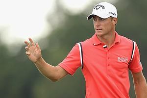 Alexander Noren celebrates during the third round of the 2011 Nordea Scandinavian Masters at Bro Hof Slott Golf Course.