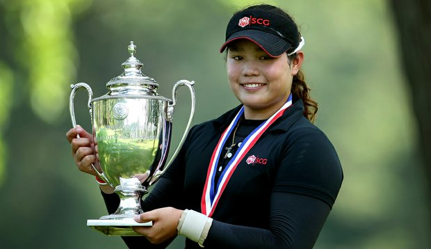Ariya Jutanugarn poses with the Glenna Collett Vare Trophy after defeating Dottie Ardina, 2 and 1, to win the 63rd U.S. Girls' Junior Championship at Olympia Fields Country Club.