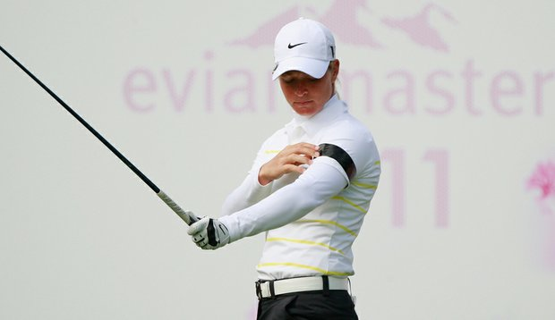 Suzann Pettersen waits on the first tee with a band on her arm after the deadly attacks in her home country during the third round of the Evian Masters.