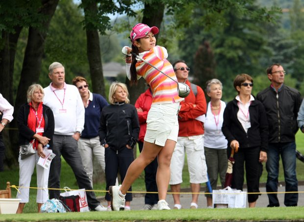 Ai Miyazato of Japan plays on the seventh hole during the four round of the Evian Masters women's golf tournament in Evian, eastern France, Sunday, July 24, 2011.