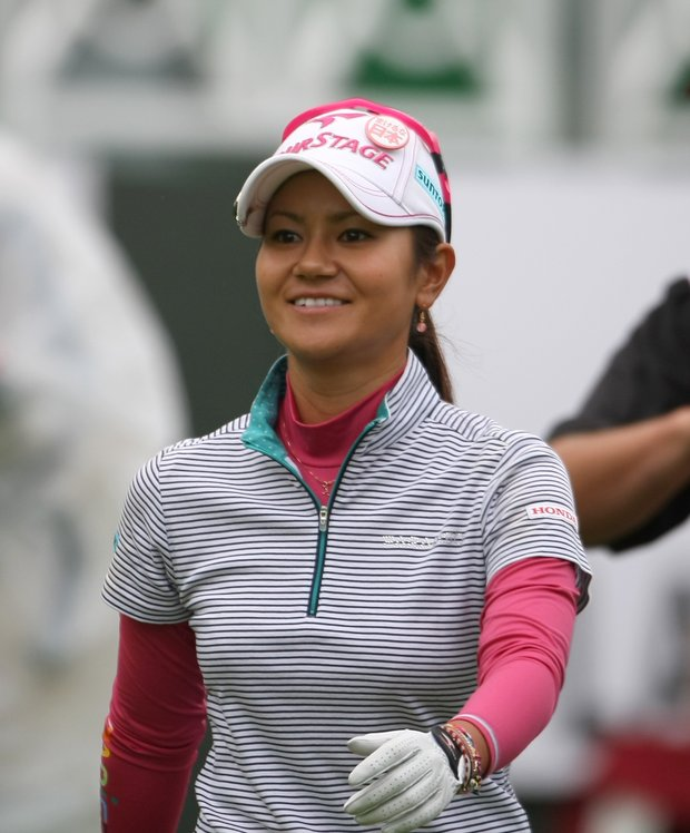 Ai Miyazato of Japan smiles during the first round of the Evian Masters women's golf tournament in Evian, eastern France, Thursday, July 21, 2011.