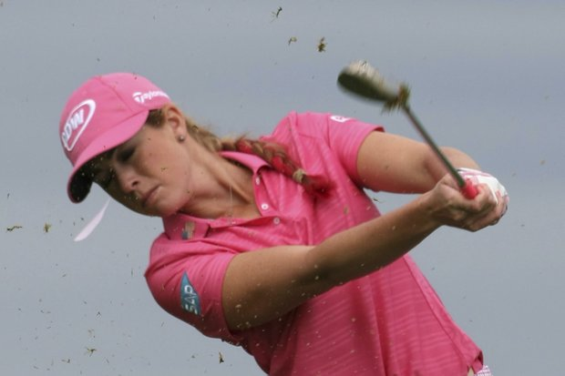 Paula Creamer of US plays on the third hole during the first round of the Evian Masters women's golf tournament in Evian, eastern France, Friday, July 22, 2011.
