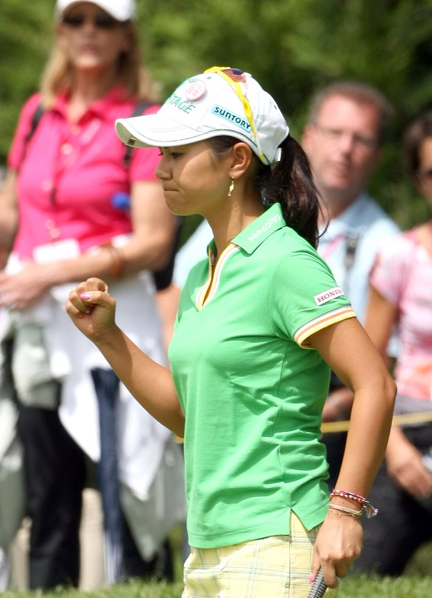 Ai Miyazato of Japan reacts on the third hole during the second round of the Evian Masters women's golf tournament in Evian, eastern France, Friday, July 22, 2011.