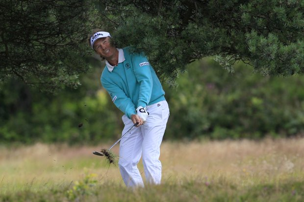 Germany's Bernhard Langer plays a shot on 2nd hole during the third round of Senior British Open Championship at Walton Heath Golf Club in Walton On The Hill, England, Saturday, July 23, 2011.