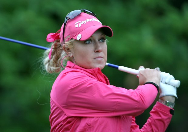 Natalie Gulbis of US plays on the third hole during the third round of the Evian Masters women's golf tournament in Evian, eastern France, Saturday, July 23, 2011.