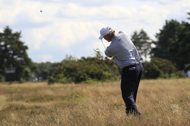 US's Russ Cochran plays a shot from the rough on the 2nd hole during the fourth round of the Senior British Open Championship at Walton Heath Golf Club in Walton On The Hill, England, Sunday, July 24, 2011.