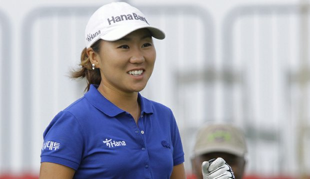 I.K. Kim of South Korea, acknowledges applause from the gallery before teeing off during the second round of the LPGA State Farm Classic.