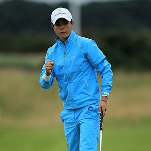 Dewi Claire Schreefel of the Netherlands celebrates holing a putt during the first round of the 2011 Ricoh Women's British Open at Carnoustie on July 28, 2011 in Carnoustie, Scotland.