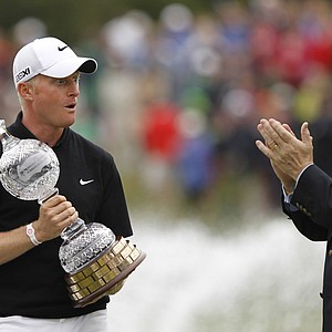 England's Simon Dyson, left, holds the Irish Open Trophy as Irish Prime Minister Enda Kenny, right, applauds him after winning the Irish Open Golf Championship, Killarney Golf and Fishing Club, Killarney Ireland, Sunday, July, 31, 2011. Dyson won the tournament finishing fifteen under par.