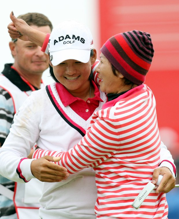 Taiwan's Yani Tseng, celebrates with her mother after winning the Women's British Open at Carnoustie Golf Club, Carnoustie, Scotland, Sunday July 31, 2011.