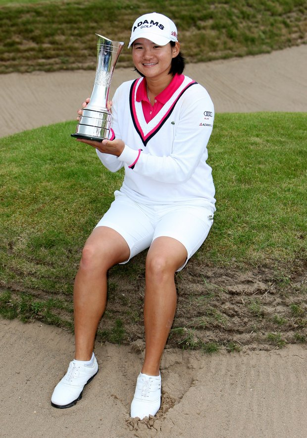 Taiwan's Yani Tseng, celebrates with the trophy after winning the Women's British Open at Carnoustie Golf Club, Carnoustie, Scotland, Sunday July 31, 2011.