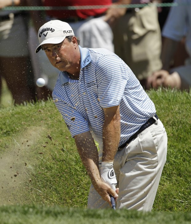 Olin Browne hits out of a bunker on the fifth hole during the final round of the U.S. Senior Open golf tournament at the Inverness Club in Toledo, Ohio, Sunday, July 31, 2011.