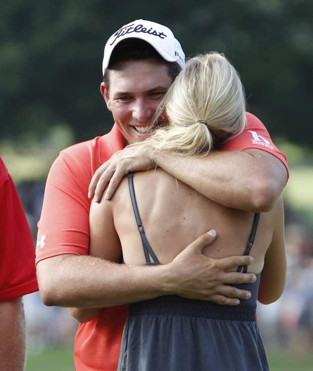 Scott Stallings hugs his wife Jennifer after winning the Greenbrier Classic PGA golf tournament at the Greenbrier in White Sulphur Springs, W. Va., Sunday, July 31, 2011.