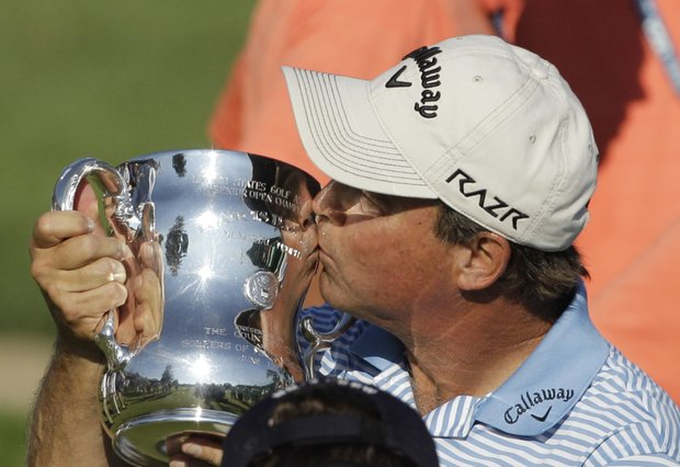 Olin Browne kisses the Francis D. Ouimet Memorial Senior Open Championship Trophy after winning the U.S. Senior Open golf tournament at the Inverness Club in Toledo, Ohio, Sunday, July 31, 2011.