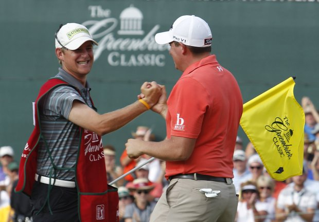 Scott Stallings shakes the hand of his caddie after winning the Greenbrier Classic PGA golf tournament at the Greenbrier in White Sulphur Springs, W. Va., Sunday, July 31, 2011.