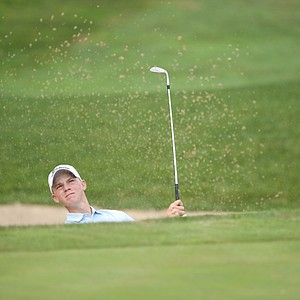Connor Black hits his ball out of the bunker on the 14th hole during the second round of play at the 36th Junior PGA Championship, at Sycamore Hills Golf Club in Fort Wayne, Indiana, USA, on Wednesday, August 3, 2011.