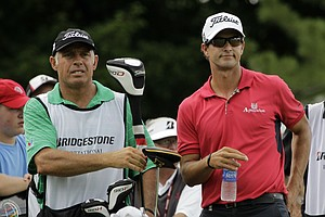 Adam Scott and his caddie Steve Williams are seen on the tee during first round play in the Bridgestone Invitational golf tournament at Firestone Country Club in Akron, Ohio on Thursday, Aug. 4, 2011.