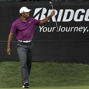 Tiger Woods reacts after making birdie on the 16th hole during first round play in the Bridgestone Invitational golf tournament at Firestone Country Club in Akron, Ohio on Thursday, Aug. 4, 2011.