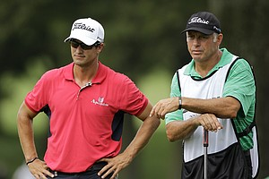 Adam Scott, right, waits on the tee with caddie Steve williams during the first round of the Bridgestone Invitational golf tournament at Firestone Country Club in Akron, Ohio Thursday, Aug. 4, 2011.