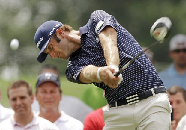 Dustin Johnson hits his tee shot on the ninth hole during the second round of the Bridgestone Invitational golf tournament at Firestone Country Club in Akron, Ohio Friday, Aug. 5, 2011.