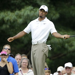 Tiger Woods reacts after missing a birdie putt on the 8th hole during the second round of the Bridgestone Invitational golf tournament at Firestone Country Club in Akron, Ohio Friday, Aug. 5, 2011.