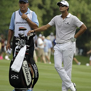 Adam Scott from Australia, right, and his caddie Steve Williams stand on the 11th fairway during second round play in the Bridgestone Invitational golf tournament at Firestone Country Club in Akron, Ohio on Friday, Aug. 5, 2011.